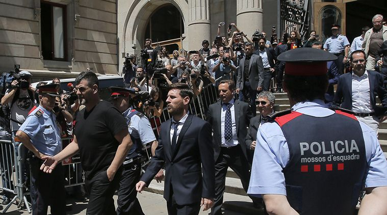 FILE - In this June 2, 2016 file photo, Barcelona soccer player Lionel Messi, center, leaves a court in Barcelona, Spain, Thursday, June 2, 2016. A Barcelona court on Friday July 6, 2016 sentenced Lionel Messi and his father Jorge Horacio Messi to suspended sentences of 21 months in prison each for tax fraud. The court found them guilty of three counts of tax fraud each. (AP Photo/Manu Fernandez, File)