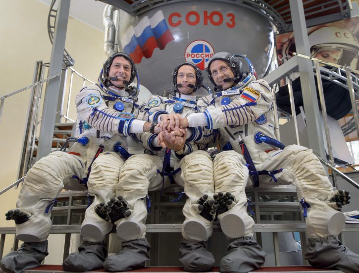 Expedition 49 NASA astronaut Shane Kimbrough, left, Russian cosmonaut Sergei Ryzhikov of Roscosmos, center, and Russian cosmonaut Andrey Borisenko of Roscosmos pose for a group photograph outside the Soyuz simulator ahead of their Soyuz qualification exams, Wednesday, Aug. 31, 2016, at the Gagarin Cosmonaut Training Center (GCTC) in Star City, Russia. Photo Credit: (NASA/Bill Ingalls)
